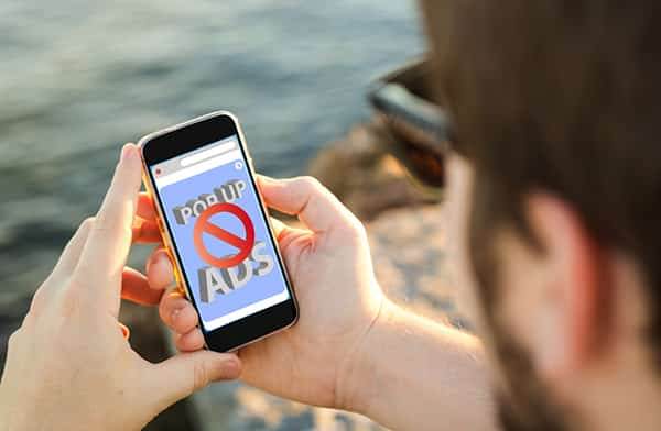 Intrusive advertising mobile blocker man on beach